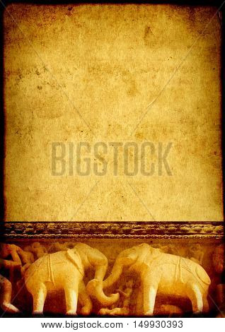 Grunge background with paper texture and carving famous elephant sculptures at temple in Khajuraho, India