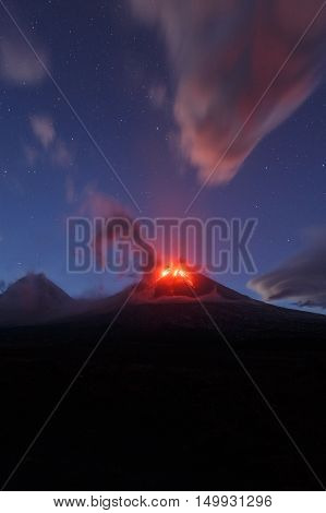 Volcanic landscape of Kamchatka Peninsula: beautiful night view of eruption active Klyuchevskaya Sopka. Eurasia Russian Far East Kamchatka Region Klyuchevskaya Group of Volcanoes.