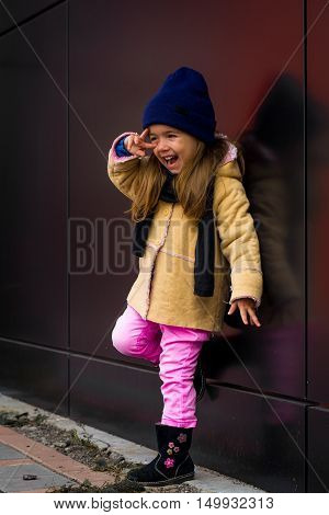 Beautiful Stylish Girl In Black Background Wall