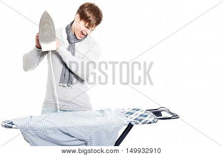 Angry Young Man Doesn't Like Ironing His Shirts -- Isolated On White..