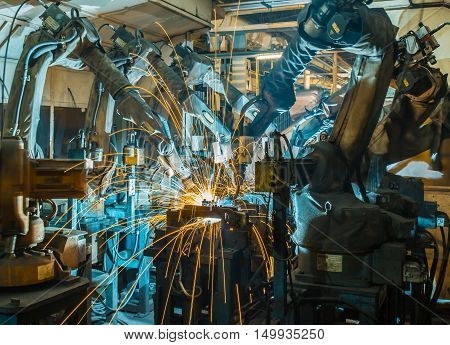 Robot welding Industrial  automotive part in factory