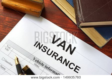 VAN insurance form on a table with a book.