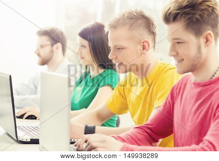 Students at the informatics and programming lesson. Education concept. Hipster color.