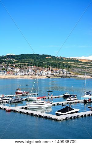 LYME REGIS, UNITED KINGDOM - JULY 18, 2016 - Yachts moored at the pontoon with views towards the Jurassic coastline Lyme Regis Dorset England UK Western Europe, July 18, 2016.