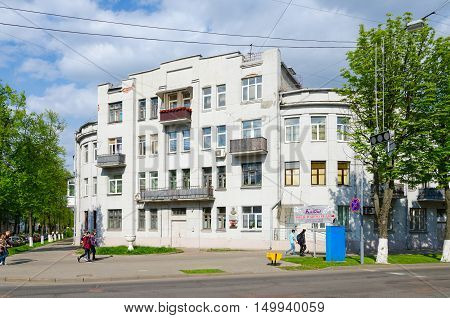GOMEL BELARUS - MAY 1 2016: Unidentified people go near old building at corner of Streets Pushkin and Artem (projects of architect S.D.Shabunevsky