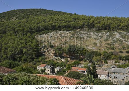 Old village Dol with caves around used for protect the village from pirates picture from Island Brac in Croatia.