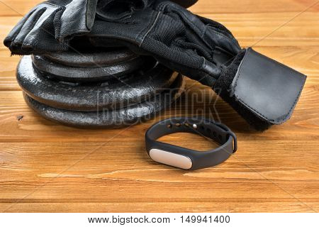 Fitness Bracelet, Gloves And Disks Weights