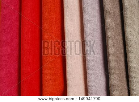 Bright collection of colorful velour textile samples. Fabric texture background