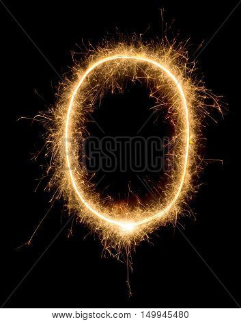 The Number Zero Is Drawn By Sparkler On An Isolated Black Background
