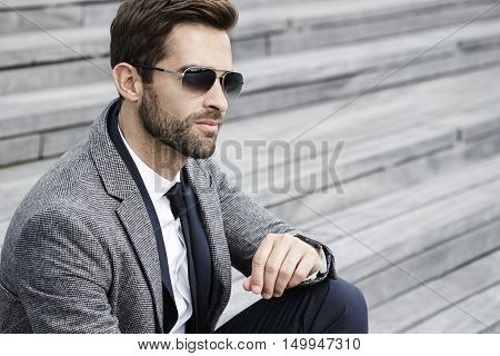 Cool business with sunglasses dude on staircase