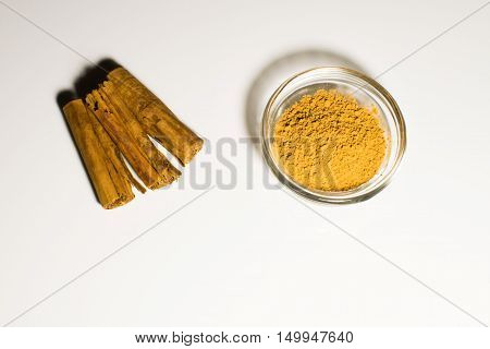 Cinnamon in two form in a white background