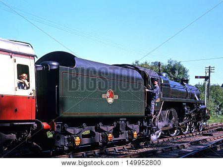 HIGHLEY, UNITED KINGDOM - JULY 18, 1993 - British Railways Standard Class 4 4-6-0 number 75069 leaving Highley railway station Highley Shropshire England UK Western Europe, July 18, 1993.