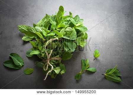 Green fresh mint on the beton table. View from abobe with space for text.