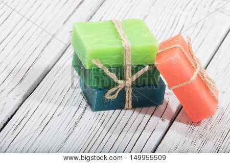 colorful natural herbal soaps on wooden background