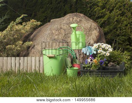 gardening tools in the garden on grass