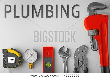 Plumbing concept. Plumber equipment on light background