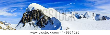 Breithorn panorama with Castor and Pollux in background viewed from Klein Matterhorn on a clear winter day.