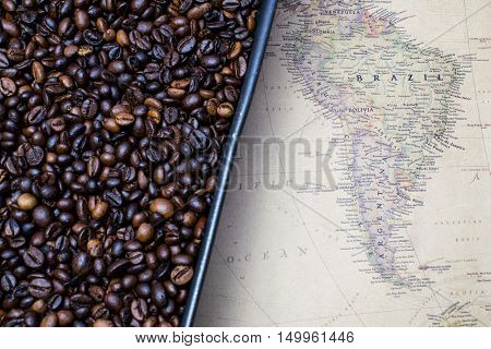 South America coffee map near coffee beans