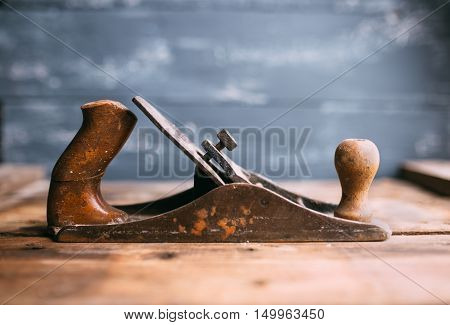 Jack-plane on old wooden table, small dof
