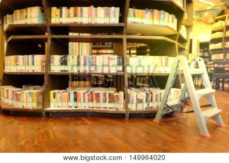 books on bookshelf in library, abstract blur background.Blurred books in public library. Blurred effect. Background.