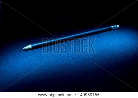 Lightpainting of a black pencil with black background
