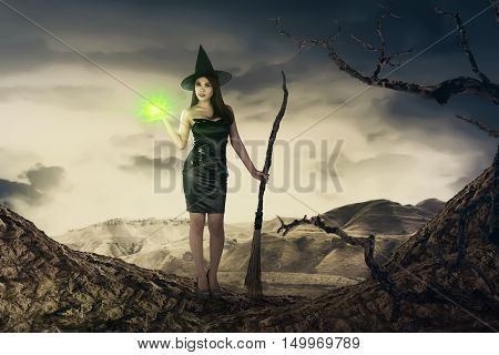 Pretty Asian Witch Woman With Magic Broom Emit Light