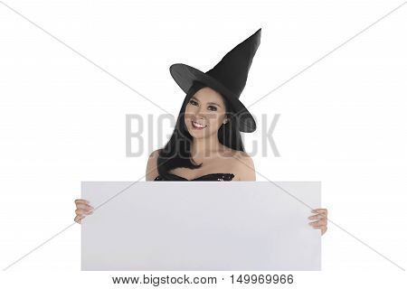 Halloween Asian Witch With Hat Holding Blank White Board