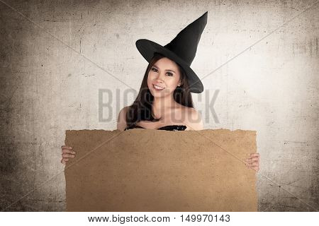 Gorgeous Asian Witch With Hat Holding Blank Parchment Paper