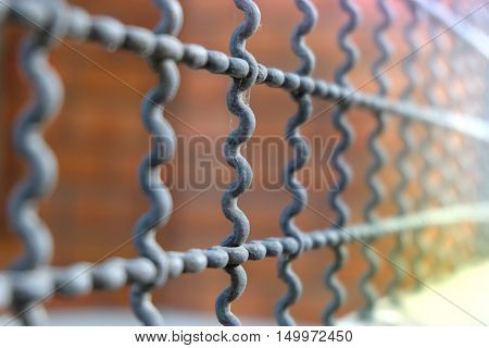 Closeup Steel wire rack or mesh fence. Steel grid protecting an entrance.