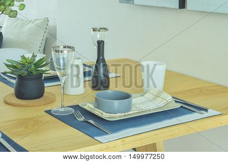 Dining set with pottery style on wooden dining table