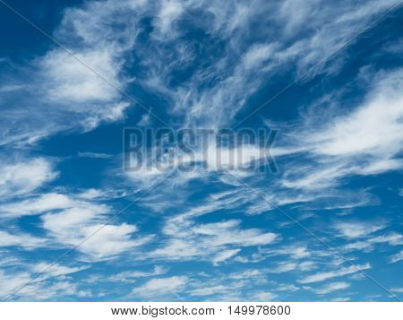 Whispy white clouds in a natural blue sky