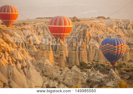 Color image of hot air balloons flying in Cappadocia Turkey at sunrise.