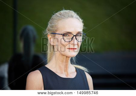 Severe Woman In Spectacles