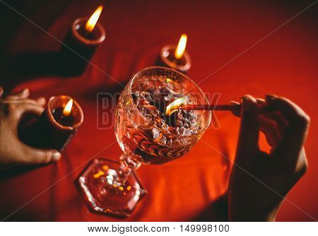 witch holds candle love spell on ritual