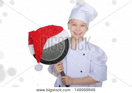 smiling girl with frying pan and Santa hat on white background with snow