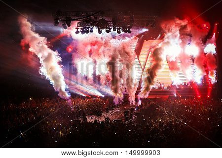 Stage Spotlight in show with Laser rays, fume, confetti and a lot of light