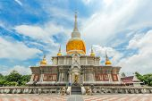 """Pagoda at Maha-Sarakham Province call """"Phrathat Nadune"""" at Mahasarakham province, Northeast of Thailand. It is public place of worship poster"""
