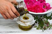 Alternative medicine remedy oil from curative herbs perfect for skin with essential oil from scented flowers poster