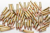 Selective focus ammunition 9mm .223 556 isolated a on white surface poster