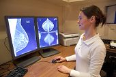 Female radiology technician examens mammography test on computer poster