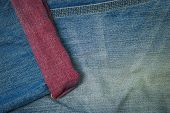 Closeup denim jeans texture. Stitched textured blue denim jeans background. Old grunge vintage denim jeans. Denim jeans with old torn of fashion jeans design. poster