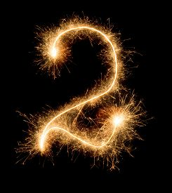 The Number Two Is Drawn By Sparkler On An Isolated Black Background