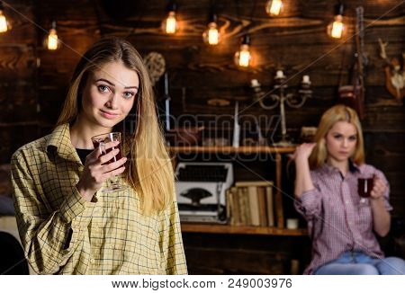 Friends On Relaxed Faces In Plaid Clothes Relaxing, Defocused. Girls Relaxing And Drinking Mulled Wi