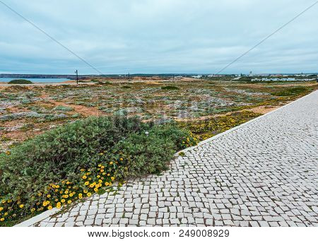 Walkway On Windswept Point And Atlantic Ocean Coast View (sagres, Algarve, Portugal).