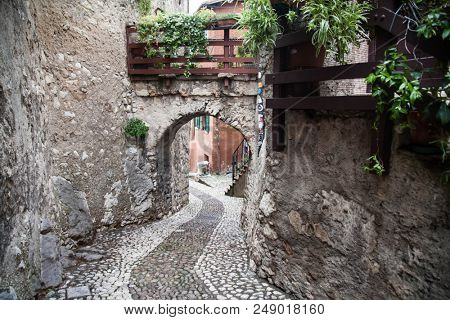 Picturesque old street in the town of Malcesine, Italy
