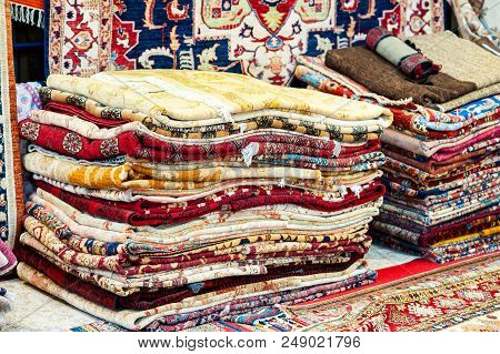 Carpets variety selection rolled up rugs shop store.
