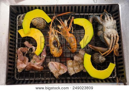 Many Food On Grill (seafood And Pork) In Restaurant