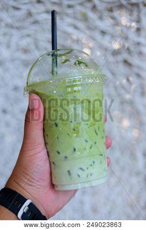 Hand Holding Ice Milk Green Tea, Summer Drink