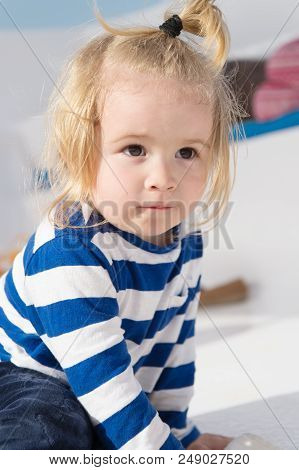 Child. Cute Child In Striped Clothes. Happy Childhood Of Little Boy Child. Child With Blong Hair. St