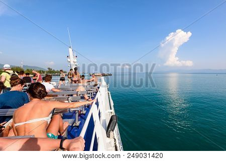 Surat Thani, Thailand-april 28, Group Of Tourists Are Resting On The Deck During The Travel By Boat